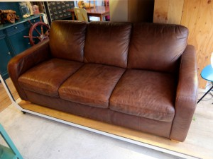 S03403471 300x225 Brown Leather 3 Person Sofa